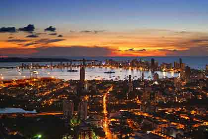 An aerial shot of Colombia with the sunset sky in the background