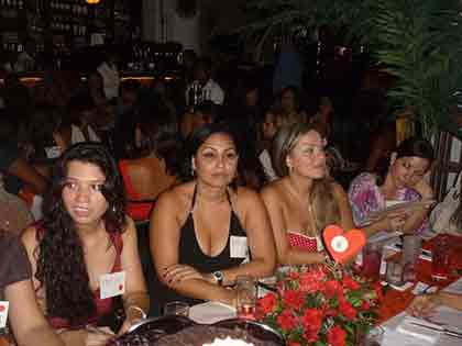 A photo of four Colombian women sitting